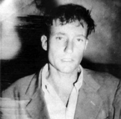 Fotografija iz policijskog arhiva Mexico Citiyja - Burroughs priveden neposredno po slučajnom ubojstvu vlastite žene, Joan Vollmer
