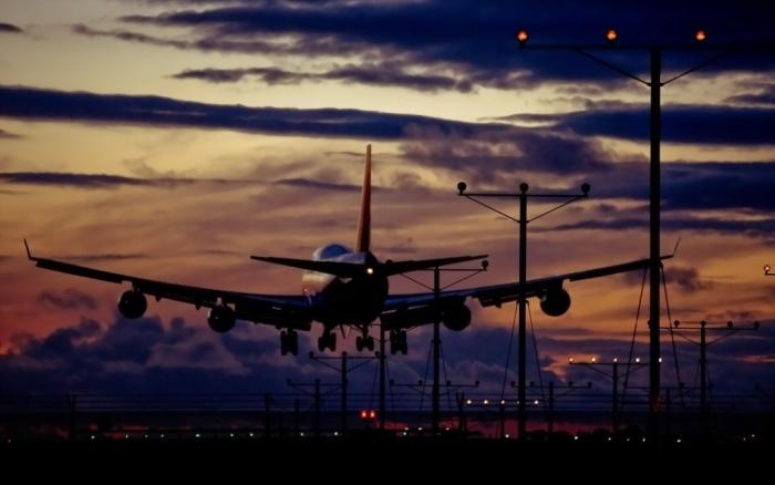 plane-night-clouds-1024x640